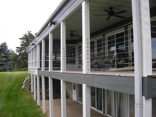 Newly constructed deck with steel gauge wire railing and clear panels so as not to obstruct the waterfront view.