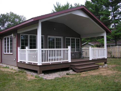 Beautiful porch and composite deck addition to the front of this home.