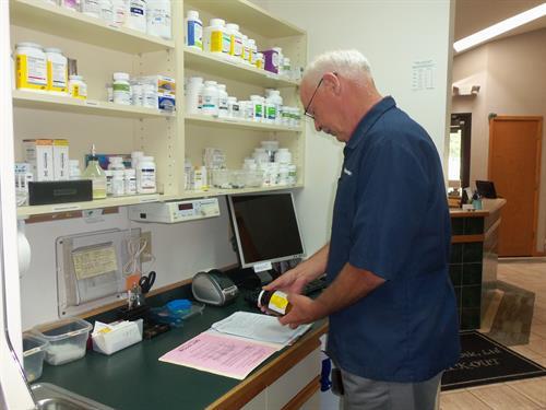 Dr. Wickersham Preparing a Prescription