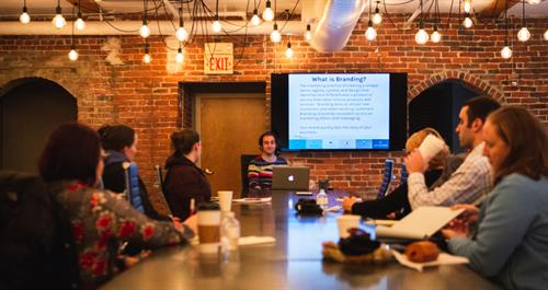 Mike giving a presentation on branding.