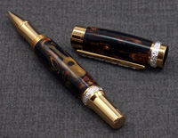 Blakley Rollerball with a barrel that has an inlaided guitar and matched with sterling silver and accents of Titanium Gold