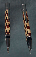 Camano Ballpoint with a barrel comprised of Maple, Redheart, and Wenge hardwoods finished with Rhodium plated hardware