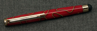 Cypress Stylus in 24K gold plating and a barrel of red, gree, and gold acrylics.