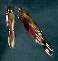 Ketron Rollerball with a barrel created from irridescent red and green acrylic finished with 24K gold plated hardware