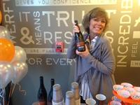 Edna our proud owner with our very own WTC wine by Northwest Cellars