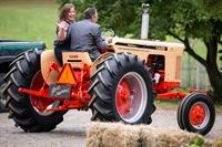 Russ French riding in restored Case tractor with bride, Kate