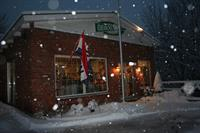 OESCO store in snow at night