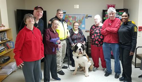 Clients enjoy a visit from Officer Doughnut!