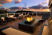 Take your cocktails to the outdoor patio seating at OverVue, and watch a stunning ocean sunset as you bask in the warmth of the fire pit.