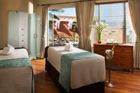 Relax and unwind with an invigorating, private couples massage courtesy of our skilled Spa staff.