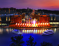 "The Branson Landing with ""The Landing Princess"" and ""The Lake Queen""  prominently watching the fire and fountains."