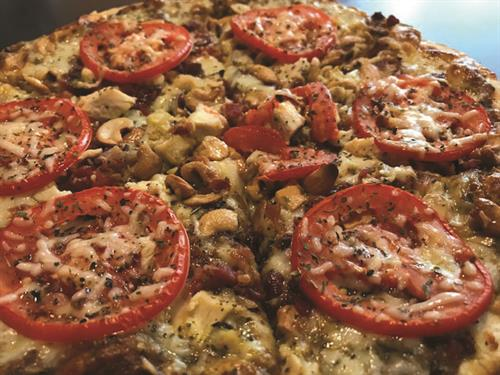 Galline (Basil Pesto, House Blend Tomato Sauce, Mozzarella, Grilled Chicken, Bacon, Sliced Tomatoes, Cashews, Shredded Parmesan, Topped with our House Blend Specialty Herbs)