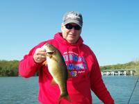 Big fish... big fisherman.  Makes the fish look small.