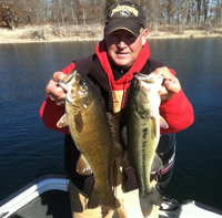 Guide Bill Babler with a nice smallmouth and spotted bass.