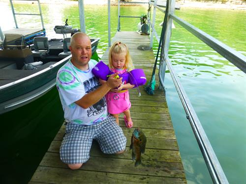 Daddy & daughter fishing! Caught a big one!