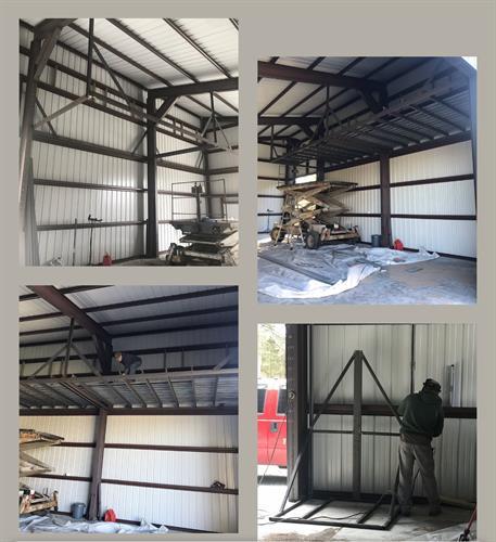 Mezzanine storage in shop with wall platform lift hoist system