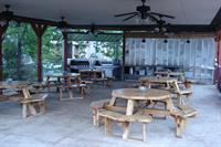 Covered pavillion with two large gas grills, stainless prep tables, lighting, ceiling fans, and comfortable seating!