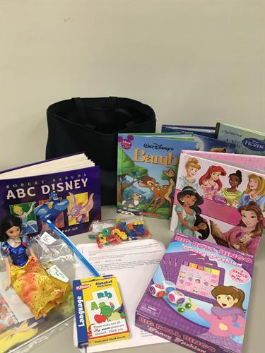 Totes for Tots Program.  Ask us how you can receive these totes delivered to your home.  Use our resources instead of buying tons of books and toys for your children.
