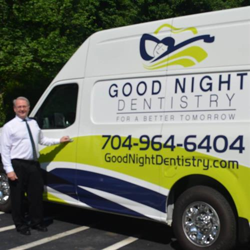 Dr. Cox with Our Company Van
