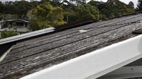 Deteriorating asbestos roof sheeting requiring replacement