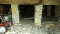 Tilting' sandstone and brick pier supports under a 1920`s bungalow