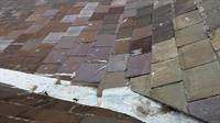 Old slate shingles on a 100-110 year old bungalow. Several different coloured shingles present indicates several repair jobs over the years….shingles are near the end of their life and should be replaced