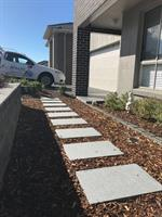 A neat and tidy installation of stepping stones and mulch.
