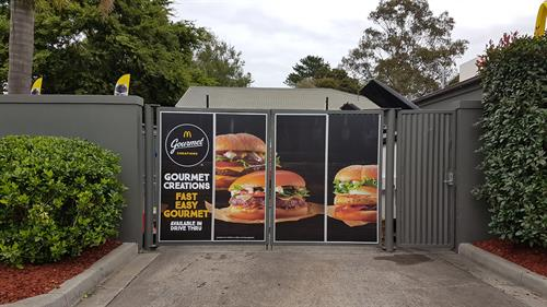 Gates with flat panels applied to resemble billboards