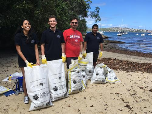 CRI cleaning up Taylors Bay Beach for Business Clean Up Day