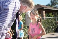 Superintendent Greg Wyman comforts a new student on the first day of school.