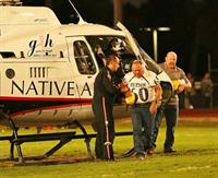 Native Air landing at Payson High School Homecoming.