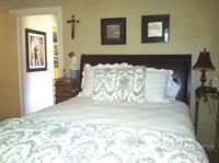 Queen size bed with quality bedding