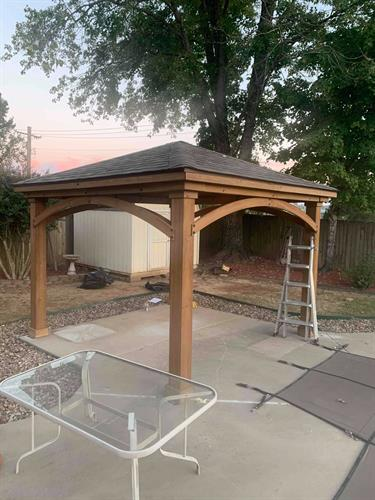 This happy customer loves their outdoor space now with the addition of this new pergola install!