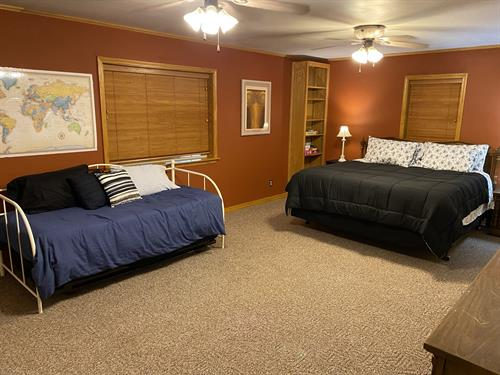 Master bedroom with comfy king bed, plus a twin day bed and trundle; smart tv