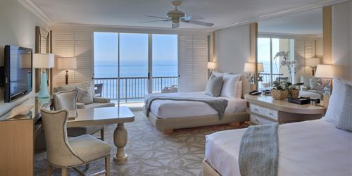 Spacious beachfront rooms with two queen beds, balconies rested above the pristine sand and views of the ocean from outside your windows
