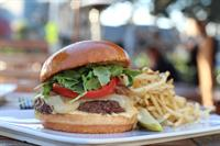KOBE BEEF HAVARTI CHEESEBURGER Caramelized Onion, Arugula, Tomato, Dijonnaise, Garlic Fries