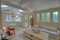 Cozy living area, custom sofa, everything to scale.