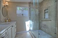 Big shower, beautiful accent tile, heated floors for cooler days.