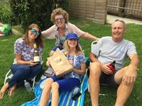 Happy family with their picnic package