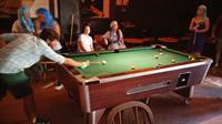 Teams competing in pool at the Sandpiper Bar in the benefit for Empower Nepali Girls Foundation