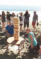 Criterion Group enjoying the Giant Jenga Team Building in front of Splashes at Surf and Sand