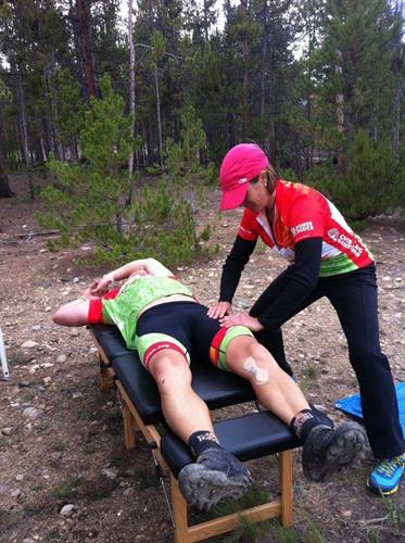 Dr. Amy serving with chiropractic care at the Leadville 100 mtn bike race