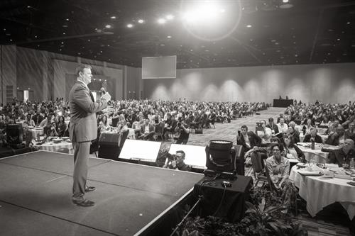 Dustin James speaking at a National Convention