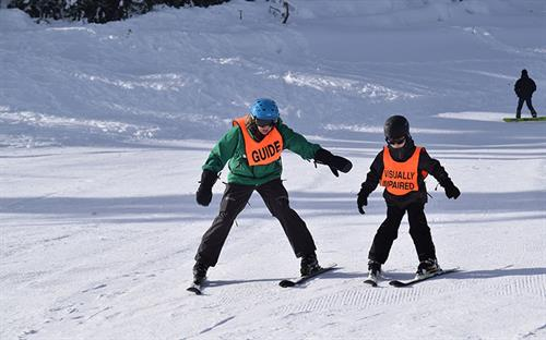 Gallery Image young-visually-impaired-skier-with-nwaba-guide.jpg