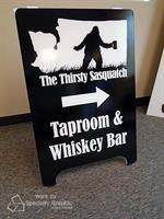 A Board graphics point the way to The Thirsty Sasquatch