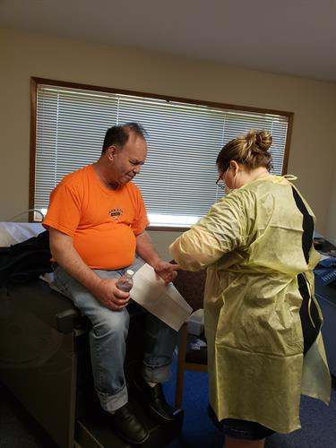 Patient receiving care during a medical clinic