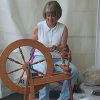 Karin spinning alpaca into yarn.