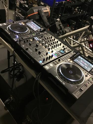 One of our DJ mixing station setups, with two Pioneer CDJ-2000nxs2 media players and a DJM-900nxs2 DJ mixer!