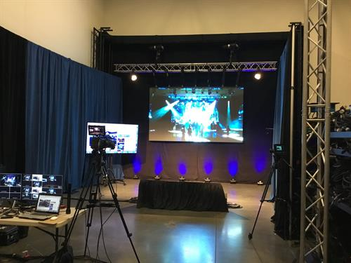 Our studio includes a pipe & drape backdrop with a removable LED video wall, which is perfect for your event logo or branding!