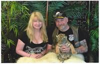 Sue and Kenny with a tiger cub.